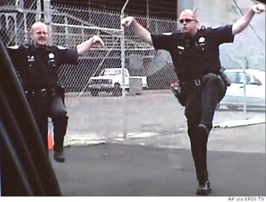 Police officers are seen in this image from video made available by authorities during a news conference in San Francisco, Wednesday, Dec. 7, 2005. One police officer was suspended and more than a dozen others face discipline after making videos parodying life on the force that used racist, sexist and homophobic stereotypes, officials announced. About 20 officers participated in creating or performing in the videos that included inappropriate and outrageous content, according to Mayor Gavin Newsom and Police Chief Heather Fong. (AP Photo/KPIX TV via The San Francisco Chronicle, Jakub Mosur) ** MANDATORY CREDIT MAGS OUT ** Ran on: 12-09-2005  Not funny: In one of the scenes from the videos that have created a furor at City Hall and beyond, two officers perform a martial-arts parody. Neither the mayor nor the police chief is laughing. IMAGE VIDEO MANDATORY CREDIT MAGS OUT BEST QUALITY AVAILABLE Photo: John Diaz
