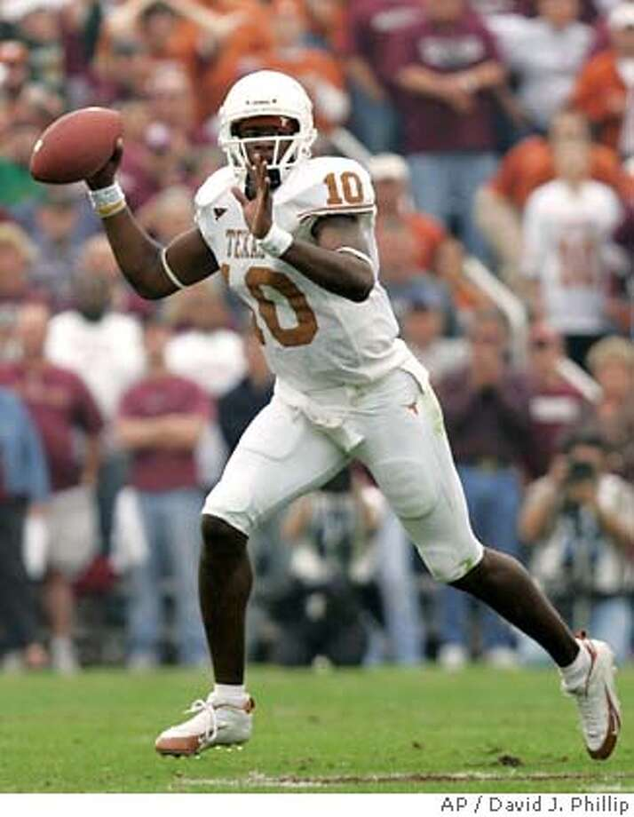 Texas quarterback Vince Young (10) looks to pass against Texas A&M during the first quarter Friday, Nov. 25, 2005 in College Station, Texas. (AP Photo/David J. Phillip) Photo: DAVID J. PHILLIP