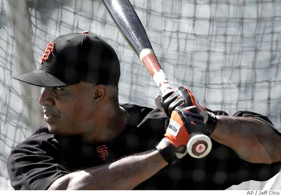 San Francisco Giants' Barry Bonds takes batting practice before the Giants game against the Chicago Cubs in San Francisco on Saturday, Sept. 11, 2005. Bonds will be activated from the disabled list Monday after being medically cleared to play by Dr. Lewis Yocum. (AP Photo/Jeff Chiu) Photo: JEFF CHIU