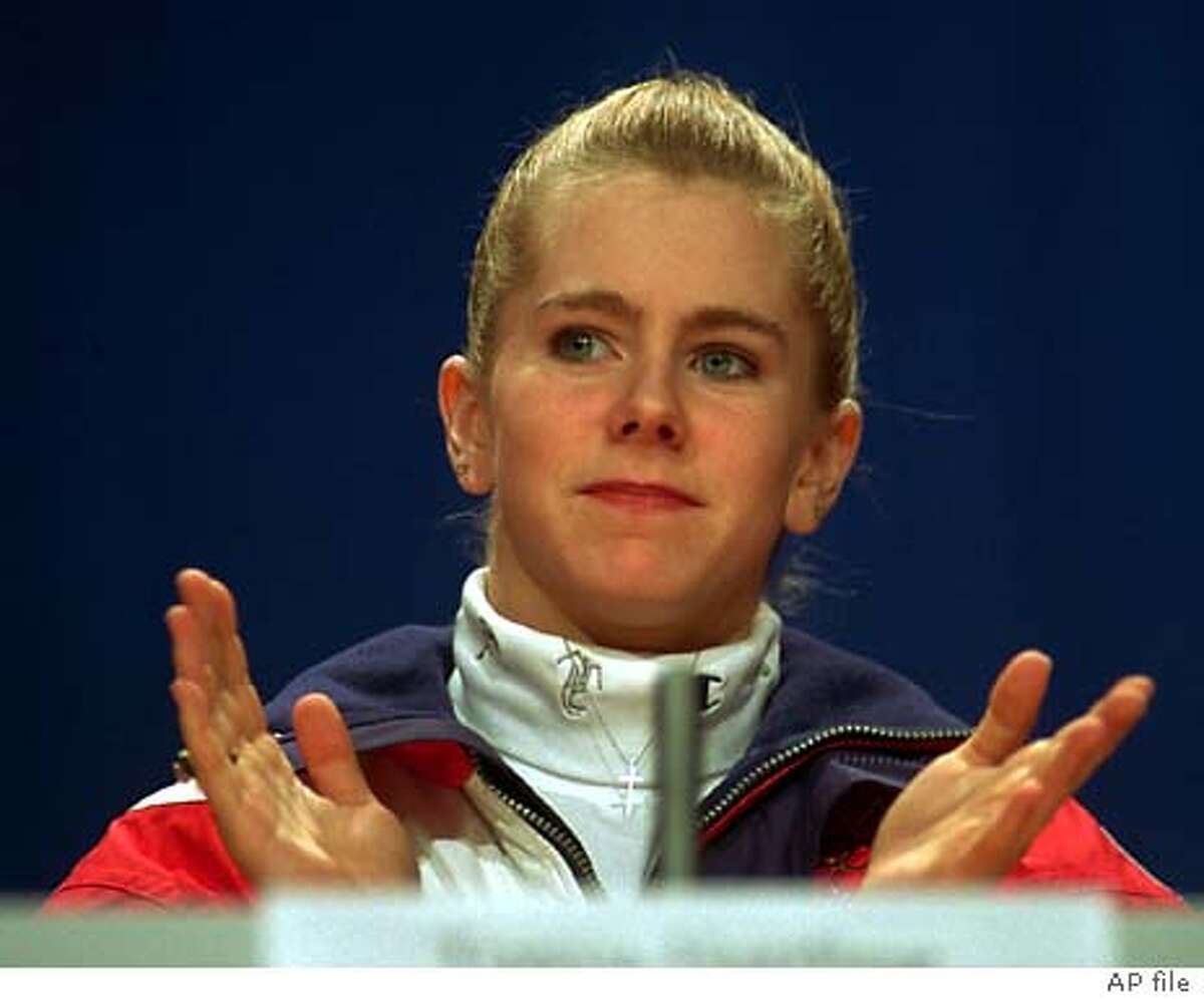 U.S. figure skater Tonya Harding gestures as she listens to reporters' questions at a news conference in Lillehammer, Friday, Feb. 18, 1994.