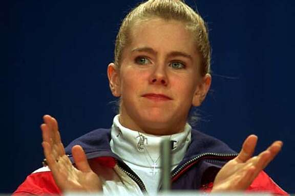U.S. figure skater Tonya Harding, of Portland, Ore., gestures as she listens to reporters' questions at a news conference in Lillehammer, Friday, Feb. 18, 1994. Harding spoke on subjects related only to her skating. (AP Photo/David Longstreath)
