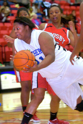 Ozen's Nekia Jones is fouled as she drives to the basket during the game against Crosby at Lee College in Baytown, Tuesday, February 14, 2012. Tammy McKinley/The Enterprise Photo: TAMMY MCKINLEY