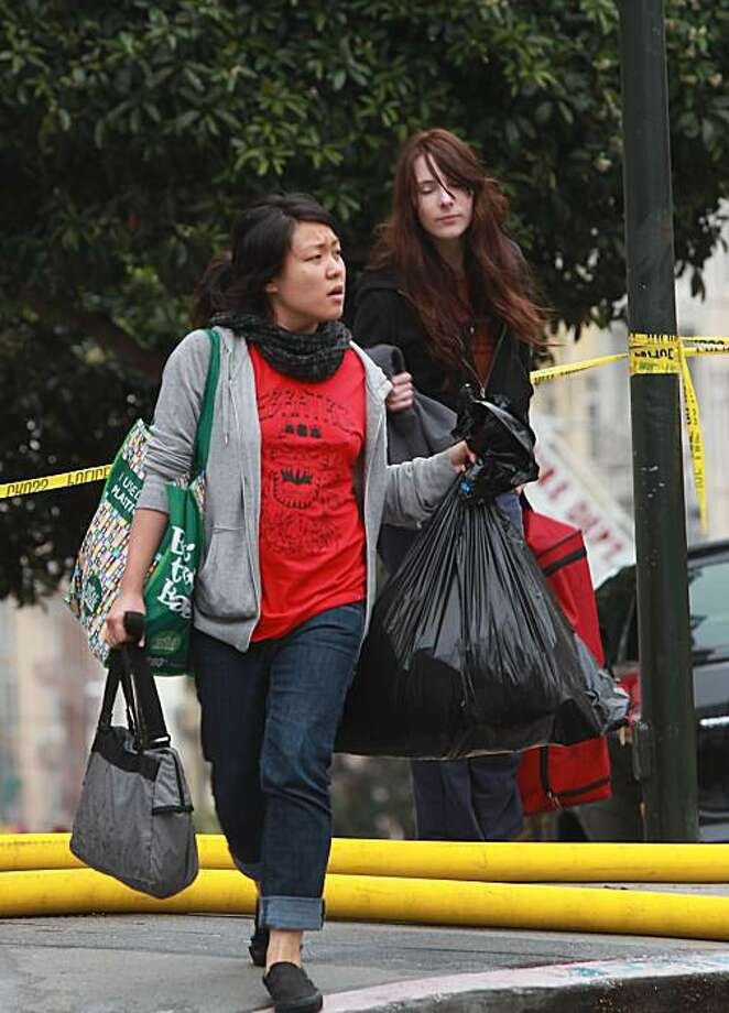 Roommates Jen Choe (left) and Annie Hackett  were evacuated to nearby St. Francis Hospital in San Francisco, Calif., after an early morning fire occurred at 824 Hyde St. on Wednesday, October 20 2010. Photo: Liz Hafalia, The Chronicle