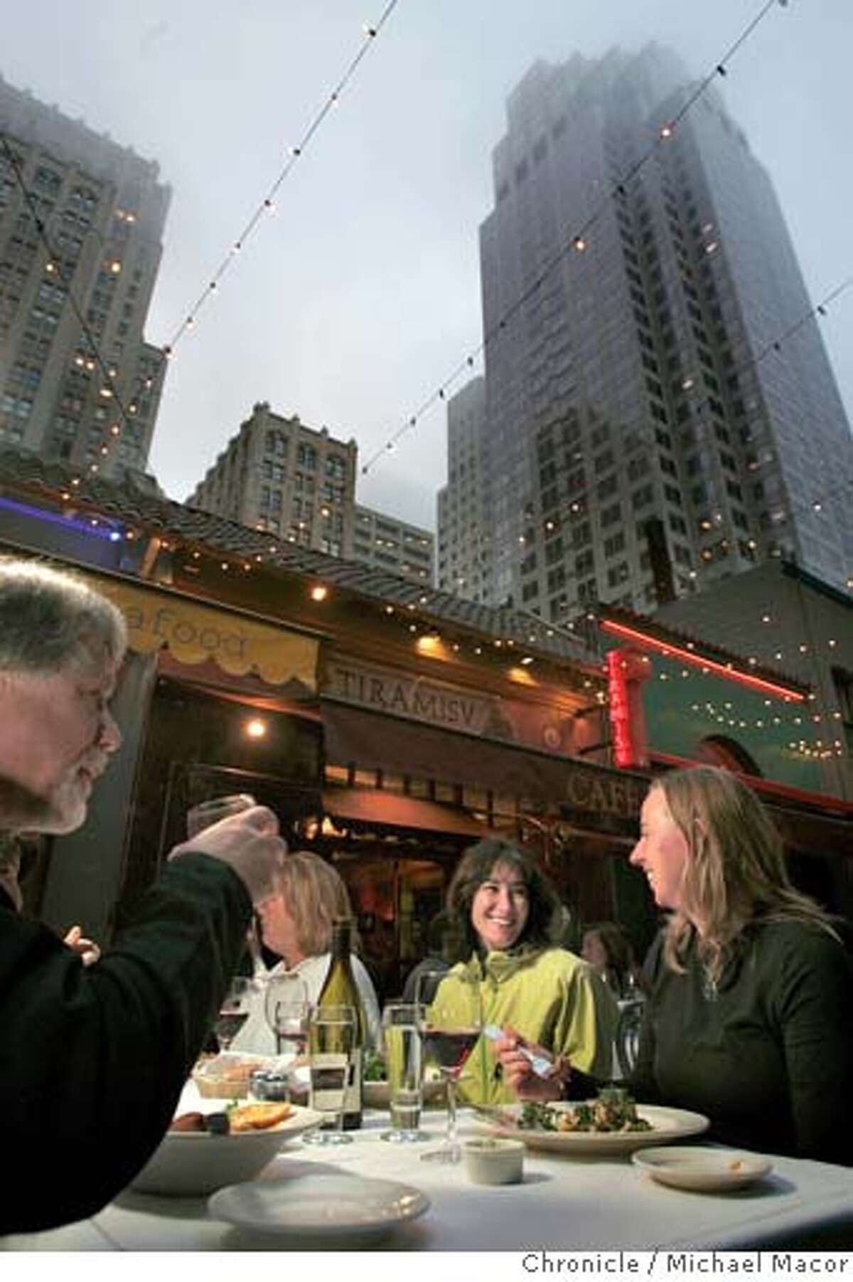 l to r-Peter Loeb, SF , Marla Bartoni, Detroit and Heather Cronin, Baltimore enjoy the outdoor seating at Plouf restaurant below the buildings at the edge of the financial district. Belden Place in San Francsico, a tiny alley that is lined with numerous restaurants. 8/11/04 in San Francisco Michael Macor/San Francisco Chronicle