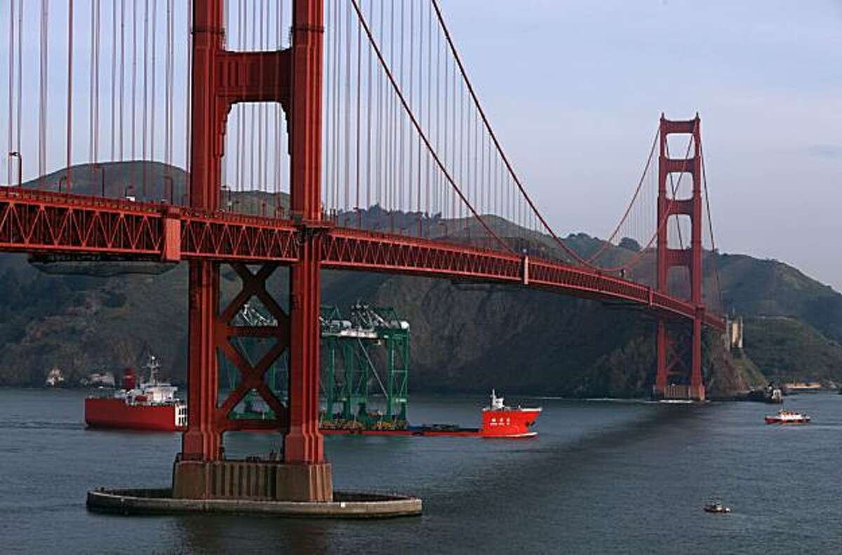 Three huge container cranes from China coming under the Golden Gate en route to the Port of Oakland.