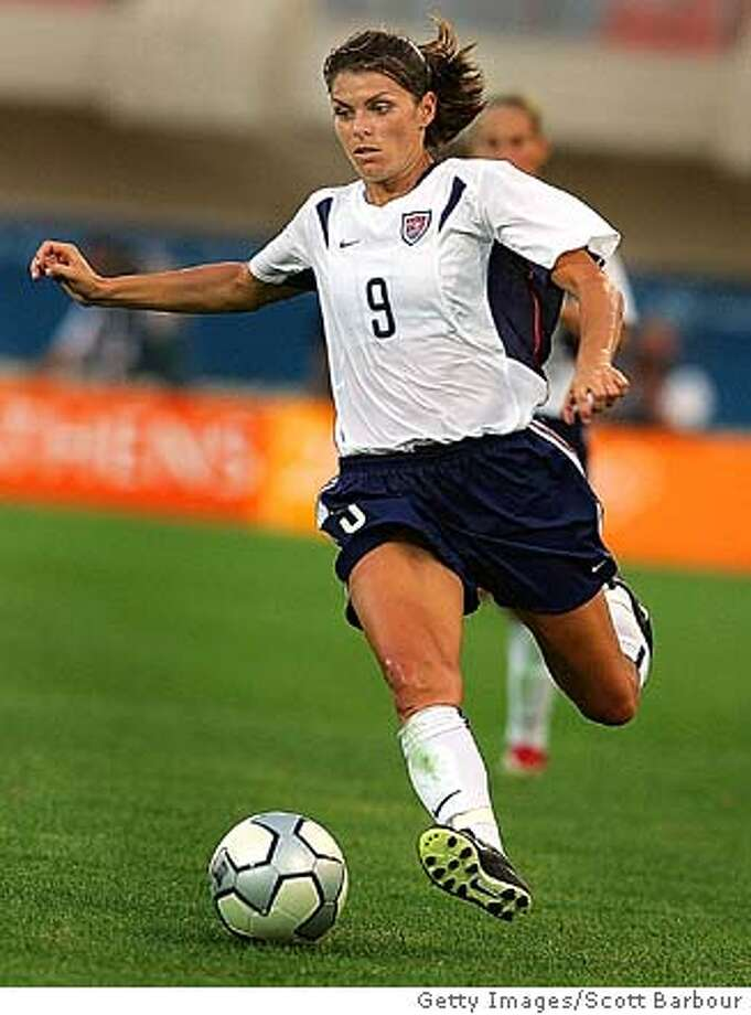 HERAKLIO, GREECE - AUGUST 23: #9 Mia Hamm of USA in action during the women's football semifinal match between USA and Germany on August 23, 2004 during the Athens 2004 Summer Olympic Games at Pankritio Stadium in Heraklio, Greece. (Photo by Scott Barbour/Getty Images) *** Local Caption *** Mia Ham Photo: Scott Barbour
