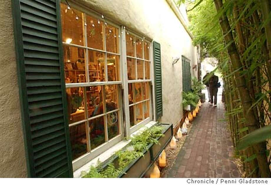 PLACE22083_pg.jpg  The Pilgrams Way bookstore at left. Customers can walk this lite walkway to get to the bookstore or the garden shop. Changes in Carmel yet still old, comfortable and cute 1/19/04 in Carmel. PENNI GLADSTONE / The Chronicle 6999 Photo: PENNI GLADSTONE