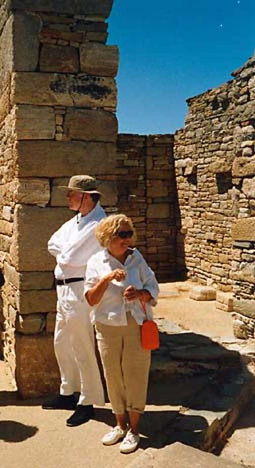 Gordon Getty (all white in hat) and Jeannette Etheredge sight-see at the Ruins of Delos in Greece. Photo: Handout