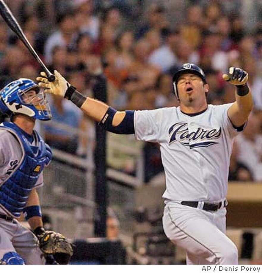 San Diego Padres' Ryan Klesko reacts as he flies out to center field as Los Dodgers catcher David Ross watches the flight of the ball during the third inning Friday, July 30, 2004, in San Diego. The Dodgers won 12-3. (AP Photo/Denis Poroy) Photo: DENIS POROY