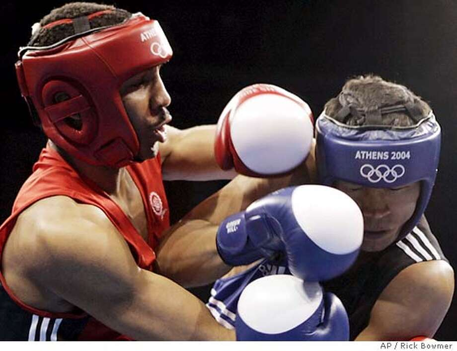 USA's Andre Ward, from Oakland, Calif., left, punches Uzbekistan's Utkirbek Haydarov during the light heavyweight boxing semifinals in the 2004 Athens Summer Olympic Games at the Peristeri boxing hall in Athens Friday, Aug. 27, 2004. Ward won the match to advance to the final. (AP Photo/Rick Bowmer) Photo: RICK BOWMER