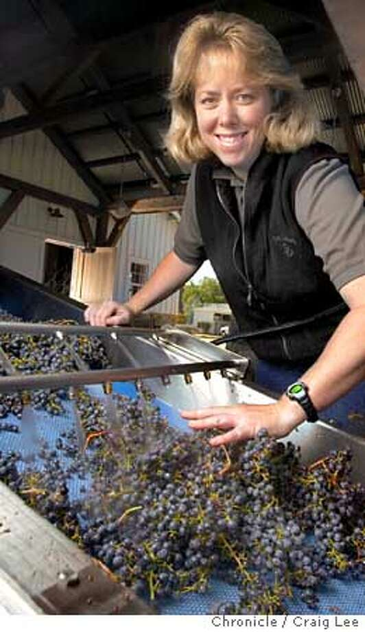 Winemakers to watch. Photo of Darice Spinelli, winemaker to watch. She is the winemaker at Nickel and Nickel in Oakville. Photo of Darice Spinelli processing the grapes for washing and crushing. These grapes are for their Stelling Vineyard Cabernet Sauvignon.  Event on 10/20/03 in Oakville.  CRAIG LEE / The Chronicle Photo: CRAIG LEE