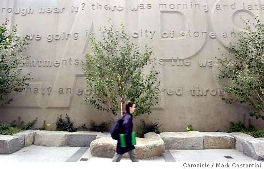 place04_0023.JPG Photo taken on 11/24/03 in San Francisco.  The outdoor plaza at 199 Fremont St plaza (corner of Howard and Fremont, which has a poetry wall largely obscured by trees.  For column on on bad logic in design.CHRONICLE PHOTO BY MARK COSTANTINI MANDATORY CREDIT FOR PHOTOG AND SF CHRONICLE/ -MAGS OUT Photo: MARK COSTANTINI