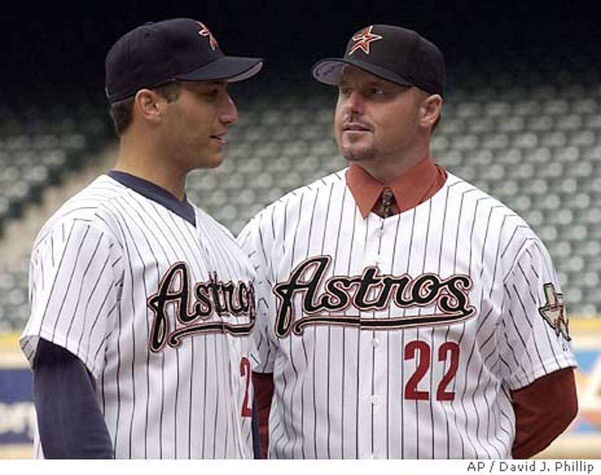 Former New York Yankee pitchers Roger Clemens, right, and Andy Pettitte talk on the pitchers mound after a news conference with the Houston Astros Monday, Jan. 12, 2004 in Houston. Clemens is pushing back his retirement, agreeing to a one-year contract with the Astros. (AP Photo/David J. Phillip)