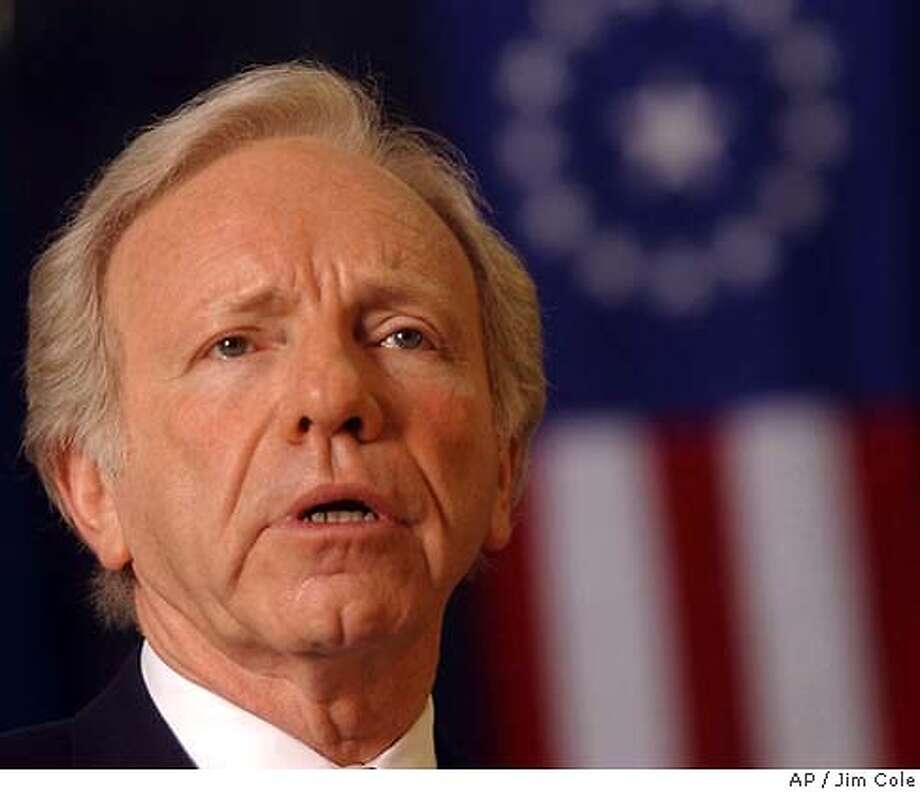"Democratic presidential hopeful, Sen. Joe Lieberman, D-Conn., gives a campaign speech at the Elks Lodge in Dover, N.H. Tuesday Jan. 13, 2004. The Elks Lodge is the same place former President Clinton gave his ""till the last dog dies"" speech. (AP Photo/Jim Cole) Wesley Clark Photo: JIM COLE"