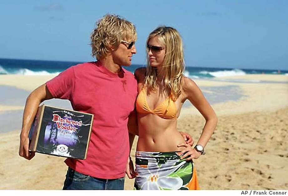 """Owen Wilson and Sara Foster in Shangri-La Entertainments """"The Big Bounce."""" (AP Photo/Frank Connor) Photo: FRANK CONNOR"""