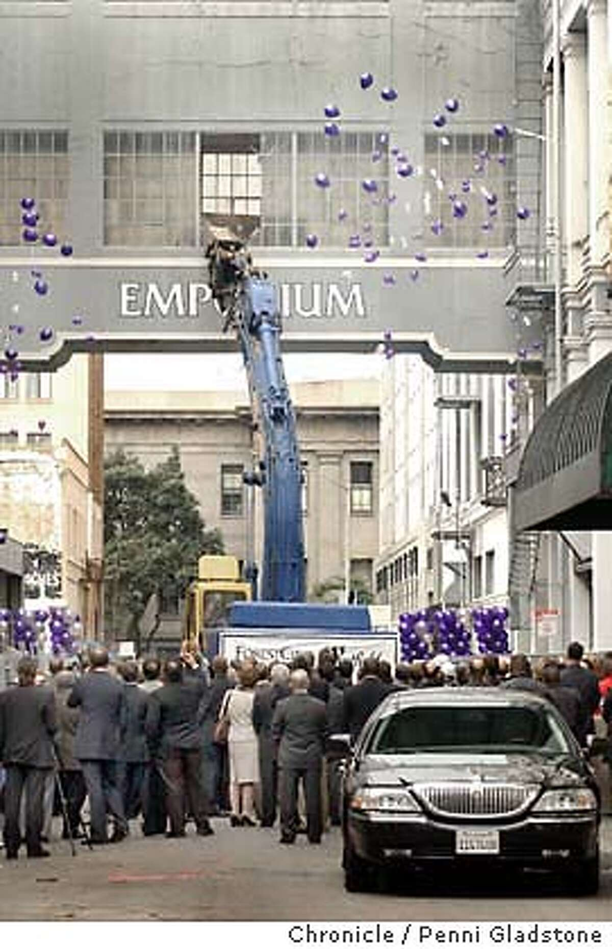 Invited spectators watch as a machine punches a hole in the empoium window walkway between Mission and Market. That's the mayors car in front. $410 million Bloomingdale's project ground breaking ceremony at old Emporium. on 11/13/03, in San Francisco, CA.. Photo by PENNI GLADSTONE / The San Francisco Chronicle