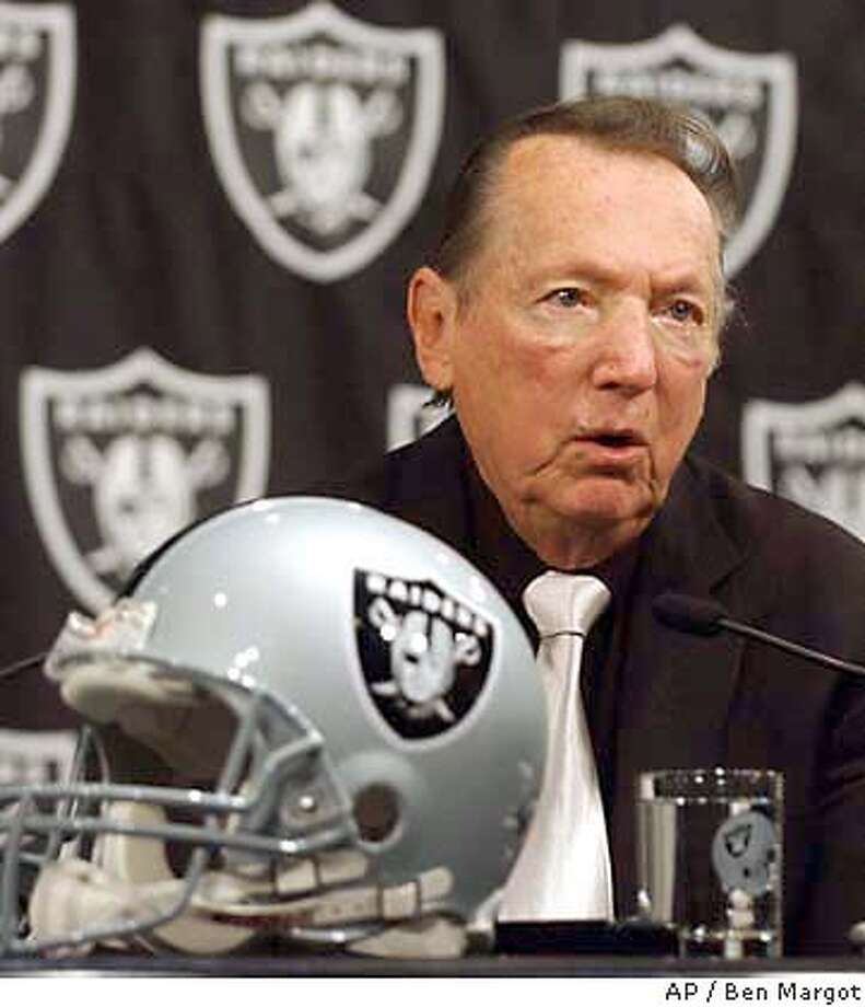 Oakland Raiders owner Al Davis speaks during a news conference announcing the hiring of the Raiders new coach Norv Turner, Monday, Jan. 26, 2004, at Raider headquarters in Alameda, Calif. Turner takes over a team that went from the Super Bowl to 4-12 in just a year. Turner coached the Washington Redskins from 1994-2000, and has been the Miami Dolphins' offensive coordinator the past two seasons. (AP Photo/Ben Margot) Photo: BEN MARGOT