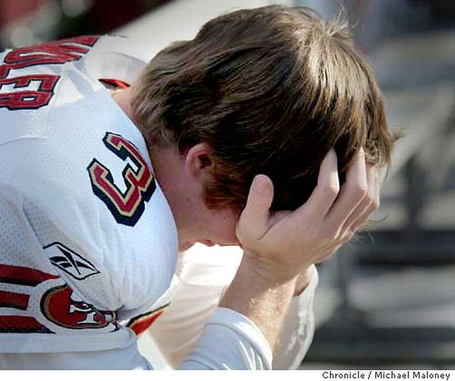 Dejection on the bench at end of game : kicker Jeff Chandler.  49ers vs Tampa Bay Buccaneers at Raymond James Stadium in Tampa Florida.  CHRONICLE PHOTO BY MICHAEL Photo: MICHAEL MALONEY