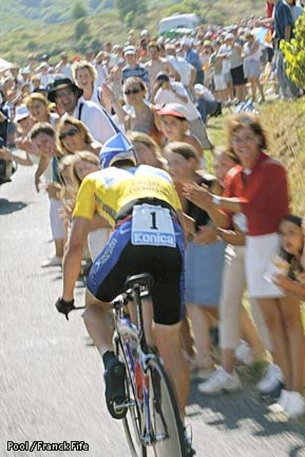 Overall leader Lance Armstrong of Austin, Texas, foreground, is urged on by supporters on his way to winning the 19th stage of the Tour de France cycling race, a 50 kilometer (31 miles) individual time trial between Regnie-Durette, central France, and Macon, Burgundy, Saturday July 27, 2002. Pool photo by Franck Fife via Associated Press Photo: FRANCK FIFE