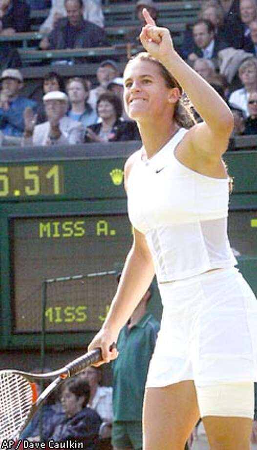 France's Amelie Mauresmo reacts after defeating Jennifer Capriati in their Women's Singles quarterfinal match on the Centre Court at Wimbledon, Wednesday July 3, 2002. Mauresmo beat the number three seed 6-3, 6-2. (AP Photo/Dave Caulkin) Photo: DAVE CAULKIN