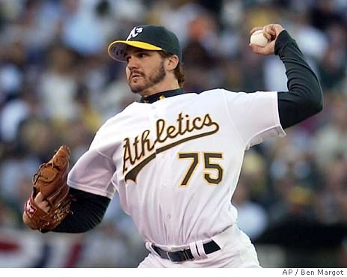 Oakland Athletics starting pitcher Barry Zito delivers a pitch in the first inning against the Boston Red Sox in game 5 of the American League Division Series playoff game, Monday, Oct. 6, 2003 in Oakland, Calif. (AP Photo/Ben Margot)
