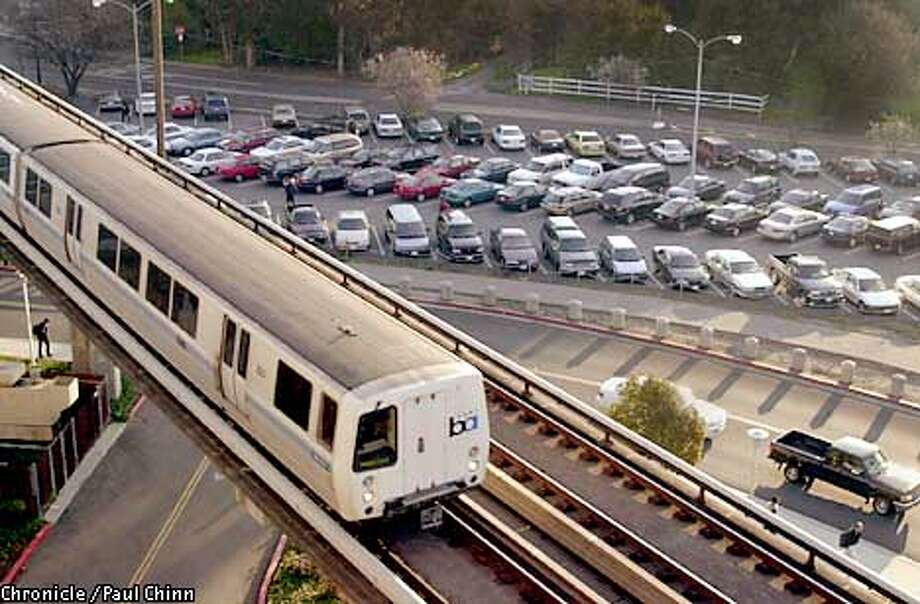 BART riders may pay more for tickets and a parking charge at the crowded lots may be imposed to help stem BART's deficit. Chronicle photo by Paul Chinn