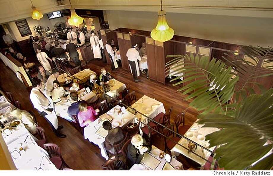 The Filllmore Grill is open nightly for dinner. SHOWN: An interior shot of the lovely restaurant, showing the intriguing booths along the far wall; grilled pork chop with broccoli rabe; shrimp, sea scallops and mussels cooked in Romesco with spinach. KATY RADDATZ / The Chronicle Photo: KATY RADDATZ