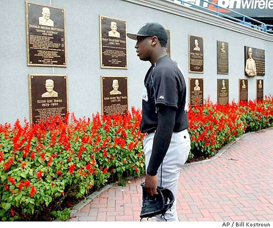 b97292c24af Florida Marlins pitcher Dontrelle Willis looks at the plaques in Monument  Park at Yankee Stadium as