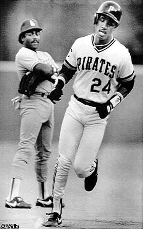 PIRATES BARRY BONDS (24) TROTS PAST LOS ANGELES DODGERS THIRD BASEMAN PEDRO GUERRERO AFTER HIS THIRD INNING TWO RUN HOMER OFF DOGERS STARTER OREL HERSHIER THURSDAY IN PITTSBURGH. Photo: HANDOUT