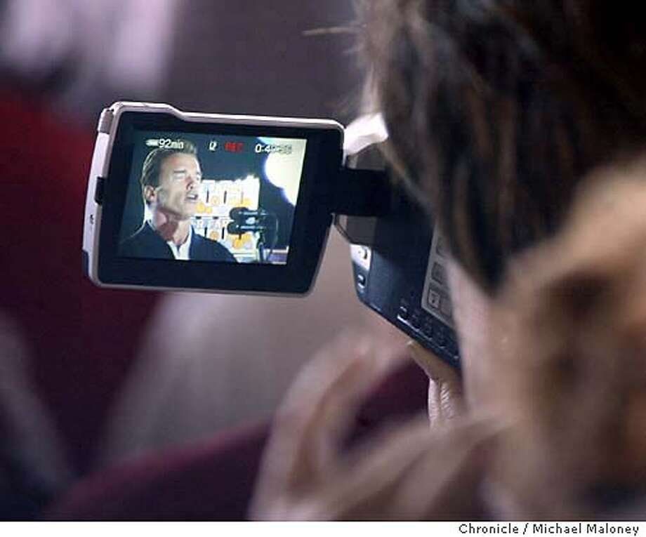 A supporter videotapes Arnold Schwarzenegger as he held a rally at P-R Farms in Clovis this morning.  The Schwarzenegger for Governor Campaign kicked off the California Comeback Express, a four-day statewide bus tour starting in San Diego and ending on the steps of the capitol in Sacramento.  Event on 10/4/03 in Clovis.  MICHAEL MALONEY / The Chronicle Photo: MICHAEL MALONEY