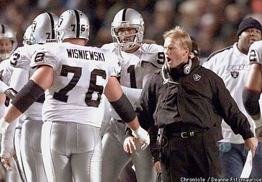 Jon Gruden, coach, congratulates his team as they come off the field after the extra point after Zack Crockett scores a TD in the 3rd quarter. Oakland Raiders beat Philadelphia Eagles at Veteran's Stadium in Philadelphia, PA.  CHRONICLE PHOTO BY DEANNE FITZMAURICE Photo: DEANNE FITZMAURICE