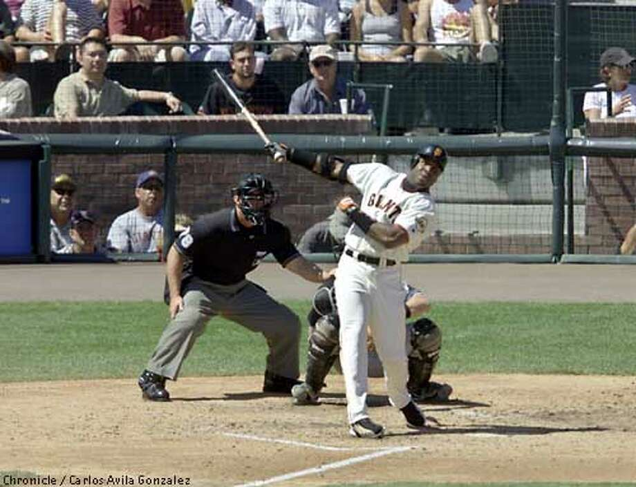 San Francisco Giants' left fielder, Barry Bonds, looks out over right field following the flight of his 60th home run as it leaves Pac Bell Ballpark, in San Francisco. Ca., against the Arizona Diamondbacks on Thursday, September 6, 2001. Bonds became only the fifth big league player in history to hit 60 home runs in one season, joining such noted players as Babe Ruth, Roger Maris, Sammy Sosa, and Mark McGwire. (Photo by Carlos Avila Gonzalez/The San Francisco Chronicle) Photo: CARLOS AVILA GONZALEZ
