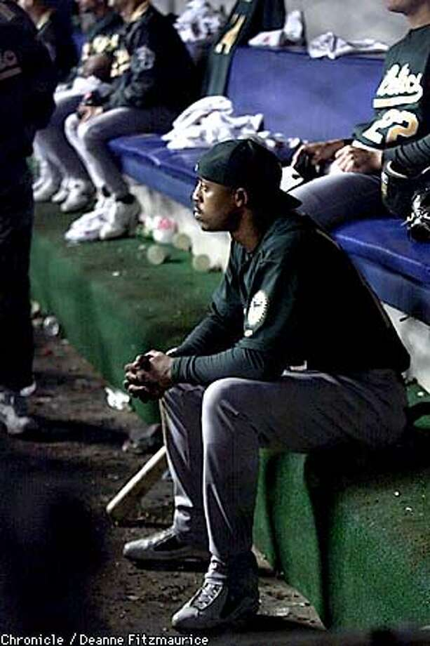 Terrence Long stares to the field from the dugout watching the Yankees celebrate their win. Oakland Athletics vs New York Yankees in Game 5 of the Divisional Playoffs at Yankee Stadium in the Bronx, NY.  CHRONICLE PHOTO BY DEANNE FITZMAURICE Photo: DEANNE FITZMAURICE