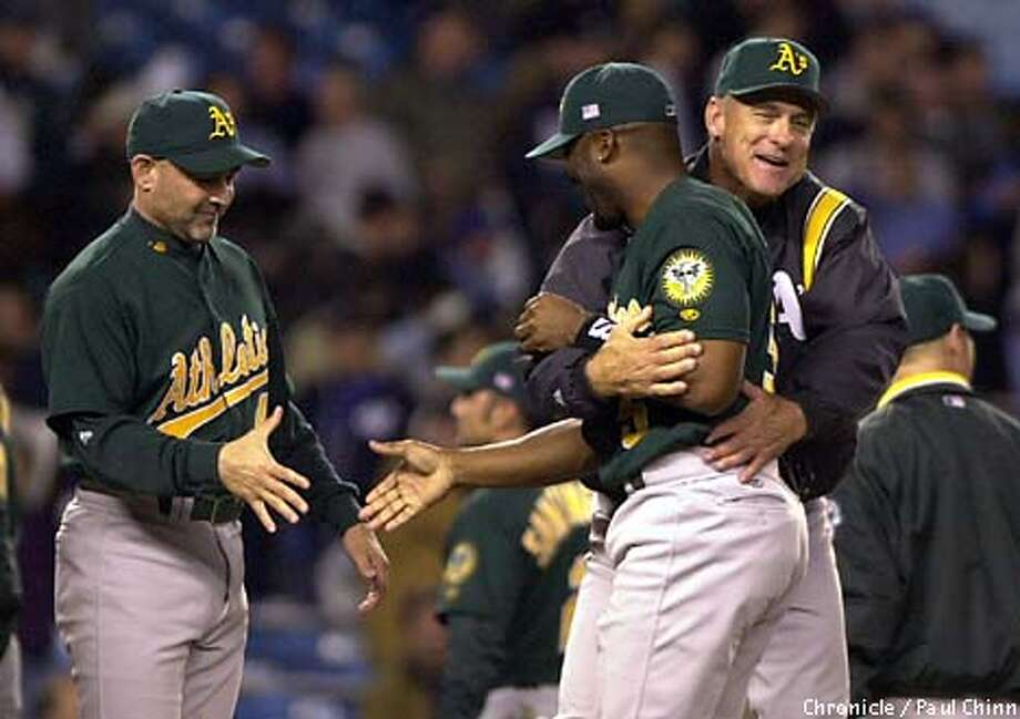 Art Howe had a big hug for Ron Gant after the game. Waiting for a handshake at left is coach Bob Alejo. The Oakland Athletics versus the N.Y. Yankees in Game 2 of the American League Divisional Series.  PAUL CHINN/S.F. CHRONICLE Photo: PAUL CHINN