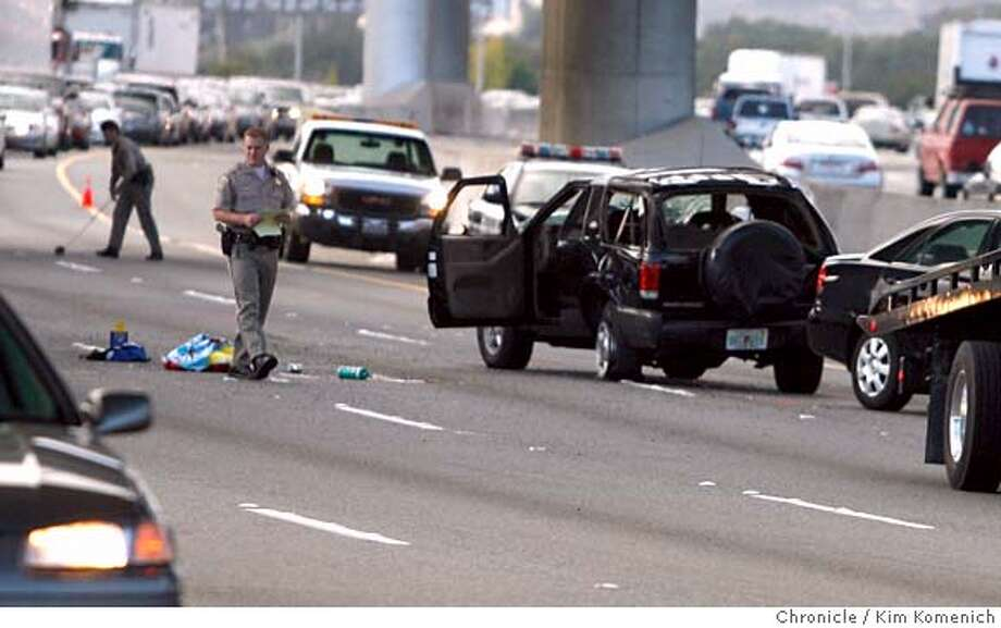 CHP officers investigate the fatal accident which happened at about 4:15pm on Highway 101 South near SFO.  Photo by Kim Komenich/The Chronicle  ** Photo: Kim Komenich