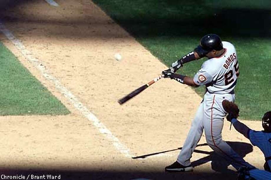 BONDSHR-09SEP01-SP-BW--Barry Bonds hit his 63rd home run of the season, his third of the game, in the top of the 11th inning at Coors field. By Brant Ward/Chronicle Photo: BRANT WARD