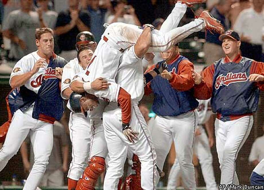 Cleveland Indians' Kenny Lofton is carried by his teammates after scoring the winning run in the 11th inning against the Seattle Mariners on Sunday, Aug. 5, 2001, in Cleveland. The Indians tied a major league record Sunday night and became the first team in 76 years to overcome a 12-run deficit to win, defeating the Mariners 15-14. John Rocker, left, got the win in relief. (AP Photo/Mark Duncan) Photo: MARK DUNCAN
