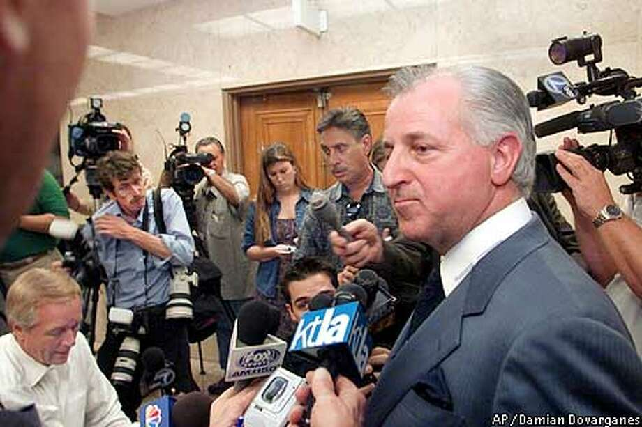 San Francisco attorney Joseph Alioto, representing Al Davis and the Oakland Raiders, answers reporters questions following a trial where they lost their $1.2 billion lawsuit that claimed the NFL sabotaged a deal for a new stadium and forced the team to leave Los Angeles Monday, May 21, 2001 in Los Angeles.(AP Photo,Damian Dovarganes) Photo: DAMIAN DOVARGANES
