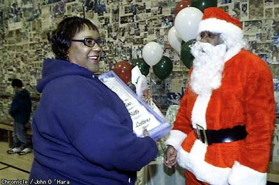 Santa gave Ledra Jones a clock and envelope holder at the Ingleside Presbyterian Church on Ocean Avenue in San Francisco. Chronicle photo by John O'Hara