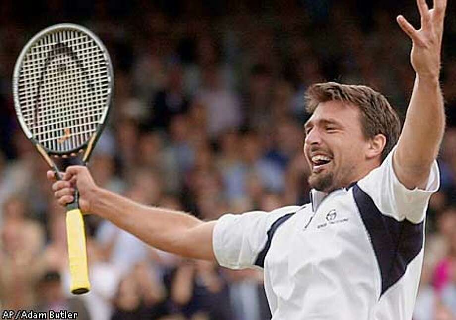 Croatia's Goran Ivanisevic reacts as he defeats Britain's Tim Henman, in their rain interrupted men's singles semifinal on the Centre Court at Wimbledon Sunday July 8, 2001. Ivanisevic won the match 7-5, 6-7. (6-8), 0-6, 7-6 (7-5), 6-3. Ivanisevic will play Patrick Rafter in Monday's final. (AP Photo/Adam Butler) Photo: ADAM BUTLER