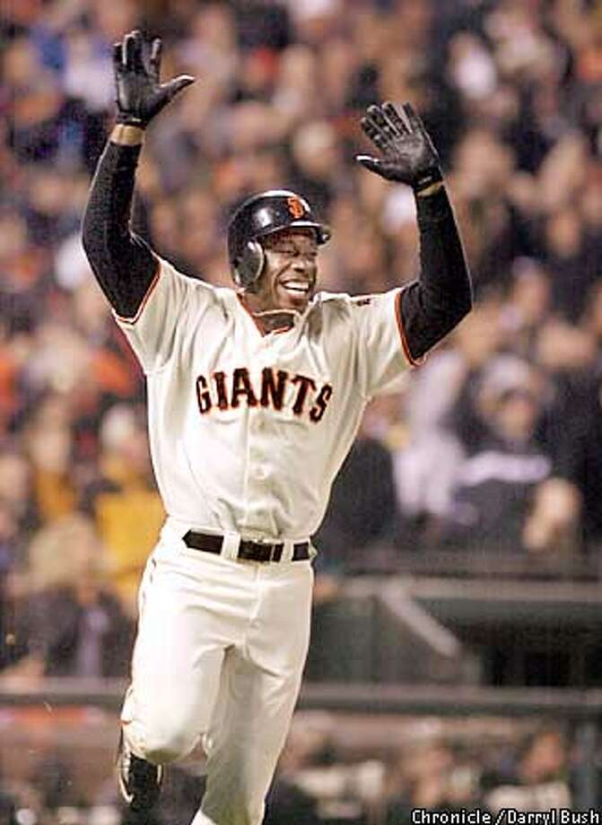 jpg Giants Kenny Lofton celebrates his ninth inning game winning single. The San Francisco Giants play the St. Louis Cardinals in game five of the National League Championship series at Pac Bell Park in San Francisco, Ca. October 14, 2002. Darryl Bush/San Francisco Chronicle Photo: Darryl Bush