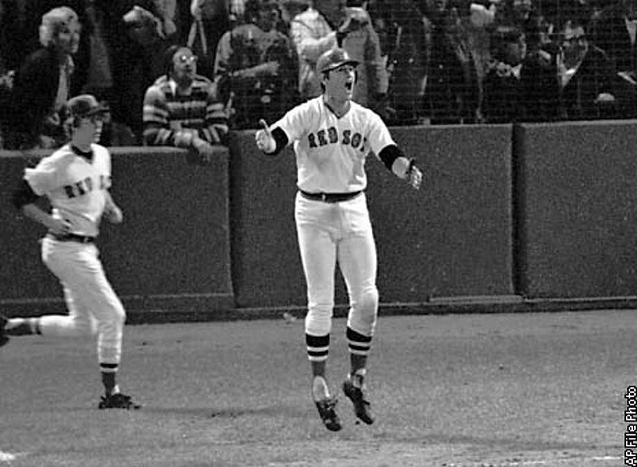 CARLTON FISK HR 21OCT75/SP/AP (in Baseball Preview.l.sp.31Mar00)--ADVANCE FOR WEEKEND EDITIONS JAN. 1-3--FILE--Boston Red Sox Carlton Fisk jumps as he watches his 12-inning home run hit the left field foul pole to beat the Cincinnati Reds in the sixth game of the World Series in this Oct. 21, 1975 photo in Boston. George Brett and Nolan Ryan appear sure to be elected to the Hall of Fame when voting is announced Tuesday, Jan. 5, 1998. Robin Yount, Carlton Fisk, Dale Murphy and Tony Perez won't know their fates until the ballots are totaled.(AP photo/hc)