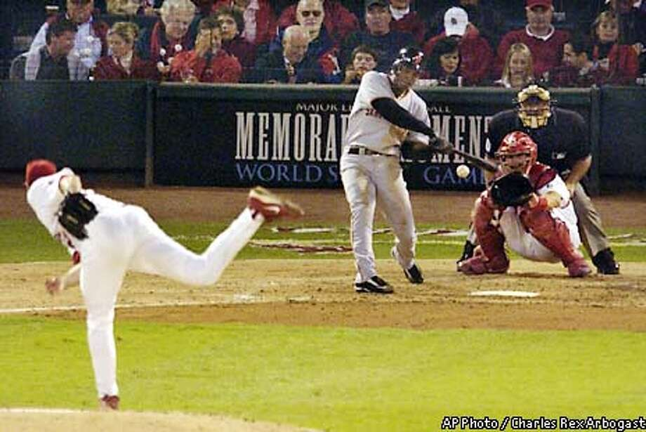San Francisco Giants' Kenny Lofton hits a solo home run off St. Louis Cardinals pitcher Matt Morris in the third inning of Game 1 of the National League Championship Series game Wednesday, Oct. 9, 2002, in St. Louis. (AP Photo/Charles Rex Arbogast) Photo: CHARLES REX ARBOGAST