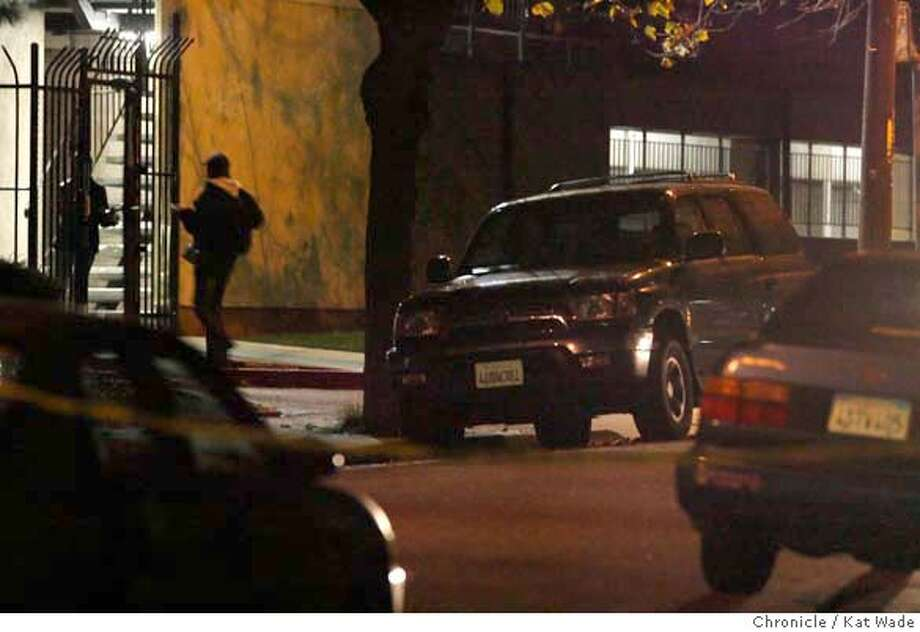 Police went door-to-door at this apartment complex at Shattuck near 53rd street searching for the shooter in a possible triple murder in Oakland at Telegraph and 52nd Street on Thursday November 23, 2006. Kat Wade/The Chronicle Photo: Kat Wade