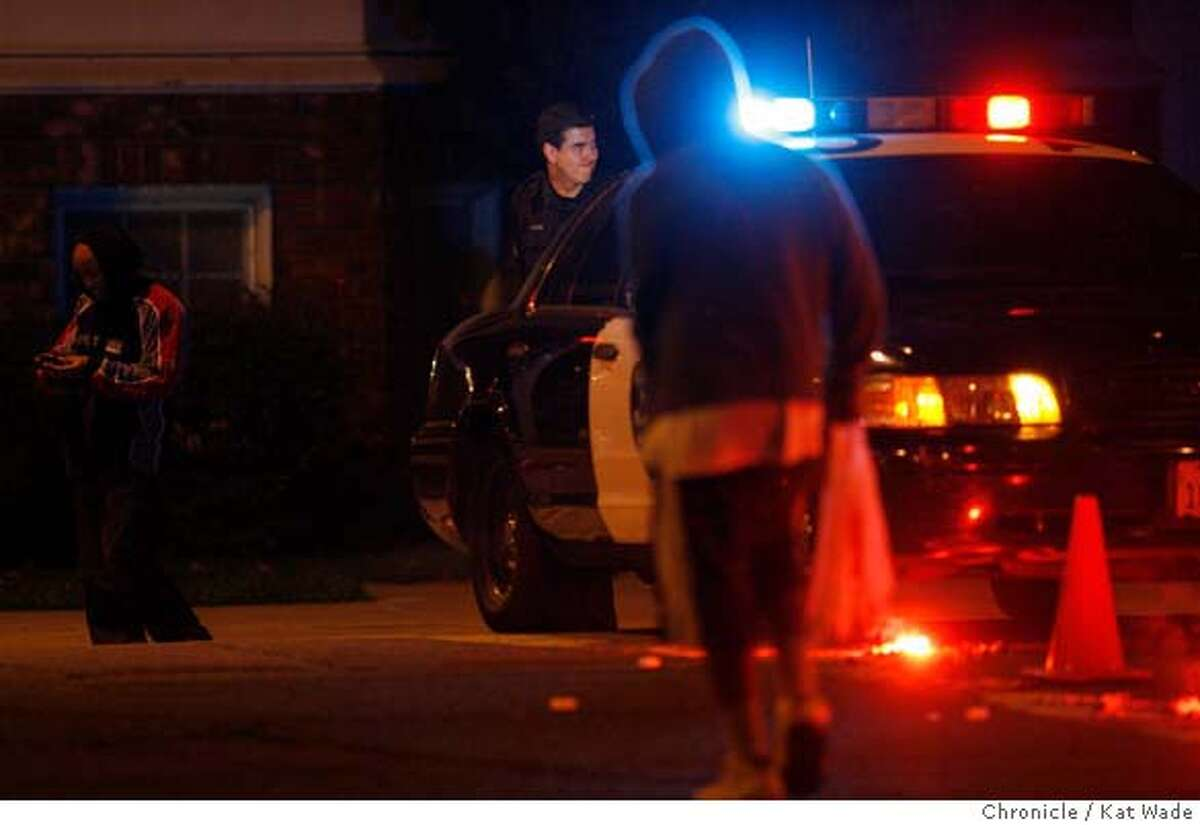 File photograph of Oakland Police Officer Bryan Clifford at the scene of a possible triple murder in Oakland at Telegraph and 52nd Street on Thursday November 23, 2006.