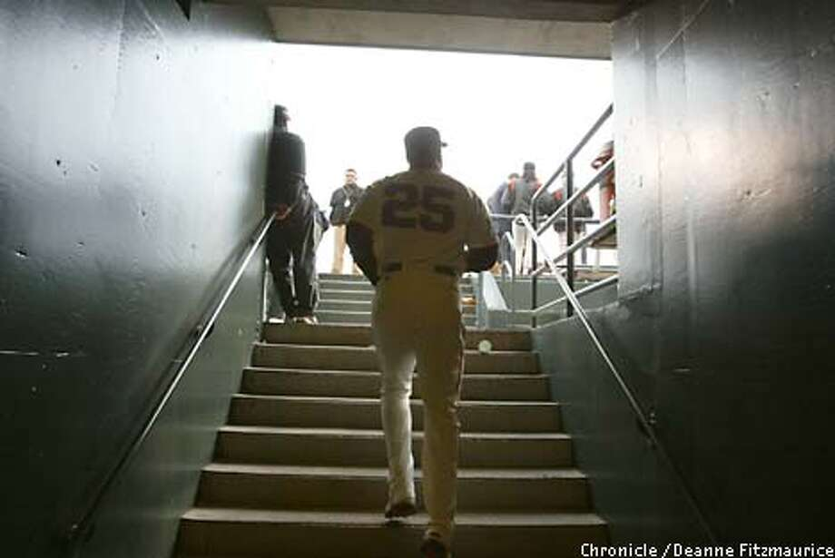 Barry Bonds walks up the clubhouse stairs to the field at Pacific Bell Park for the final time this season. Chronicle photo by Deanne Fitzmaurice