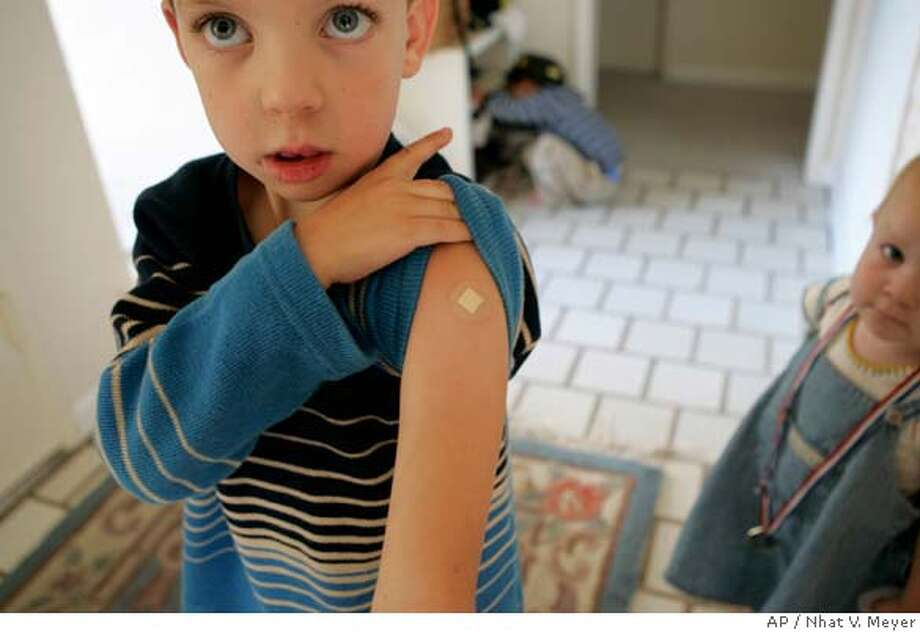 Andrew Packard, 4, shows where he received a rabies shot following a squirrel attack at a park, in Mountain View, Calif, at his home in San Jose, Calif., Monday, Sept. 25, 2006. Aggressive squirrels have bitten at least three people in the past three months, prompting a warning to beware of the rodents. (AP Photo/San Jose Mercury News, Nhat V. Meyer) Photo: NHAT V. MEYER