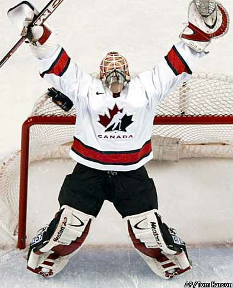 Team Canada's goalie Martin Brodeur celebrates his team's fifth goal by teammate Joe Sakic during third period men's hockey gold medal final against the United States, at the 2002 Salt Lake Olympic Winter Games in West Valley City, Utah, Sunday, Feb 24, 2002. Canada won 5-2.(AP Photo/Tom Hanson) Photo: TOM HANSON