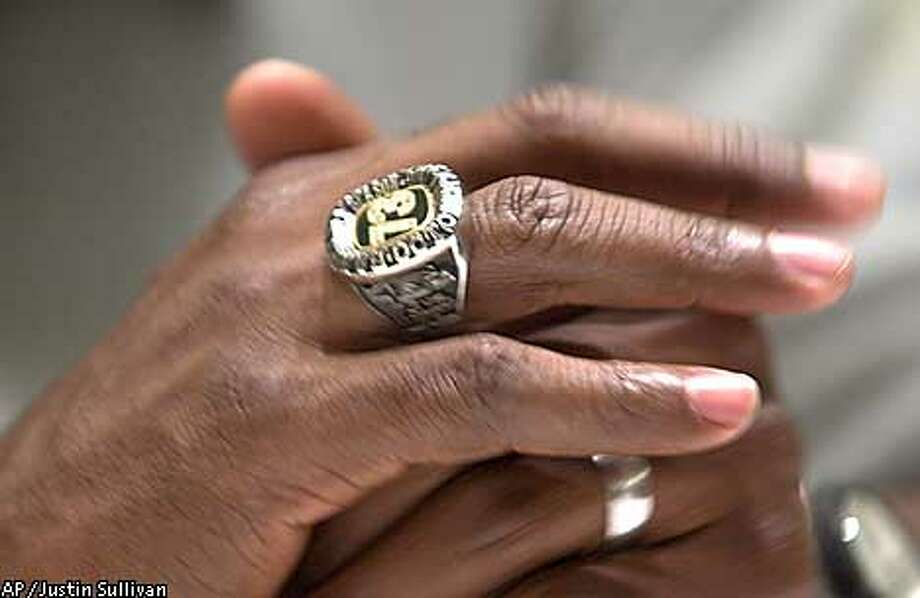 "San Francisco Giants' Barry Bonds wears a ""73"" ring during a news conference to announce his re-signing with the Giants in San Francisco on Monday Jan. 14, 2002. Bonds' five-year contract is worth $90 million. The ring was given to him by a friend in honor of his home run record. (AP Photo/Justin Sullivan) Photo: JUSTIN SULLIVAN"
