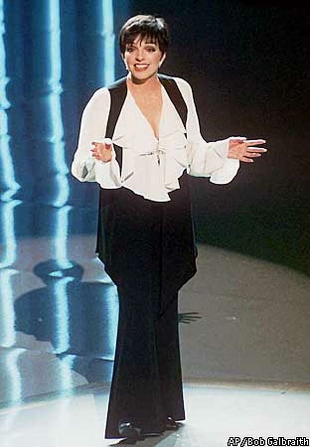 """FILE-- Liza Minnelli, shown in this March 29, 1993, file photo, returns to Broadway this month for the first time in 12 years, starring in ``Victor/Victoria'' while Julie Andrews takes a month off. """"That is what the theater is all about, that you help each other,'' Minnelli , 50, says in the Jan. 13, 1997, issue of New York magazine. (AP Photo/Bob Galbraith)"""